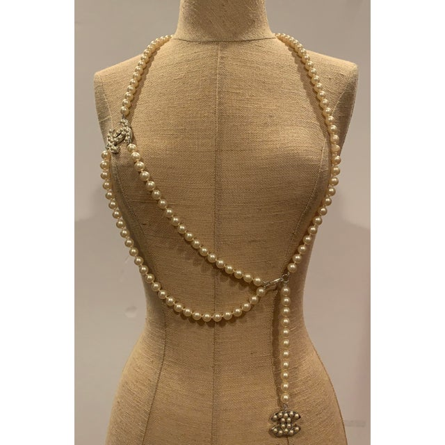 """Beautiful Chanel faux pearl belt will surely bring a bit of elegance to any wardrobe. The belt is 42"""" long from end to..."""
