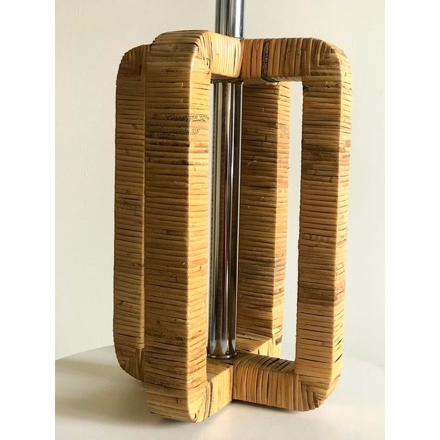 A well designed lamp in reed rattan and chrome from the seventies. In the style of Milo Baughman.