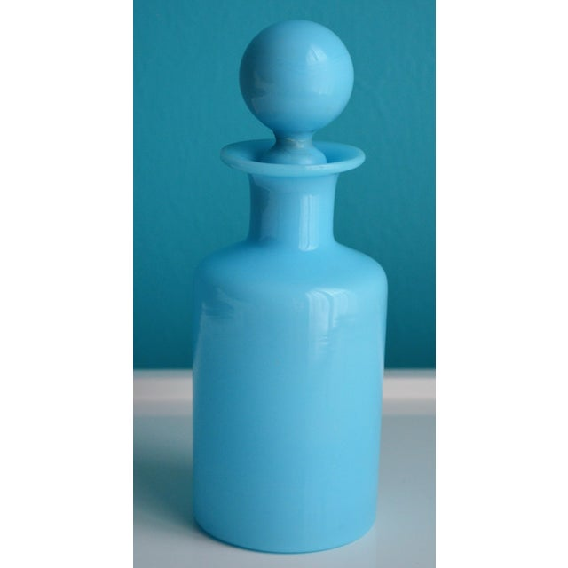 This is a French antique Portieux Vallerysthal blue opaline glass perfume bottle with a rounded lid. Great accessory for a...