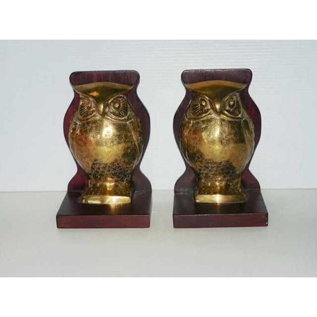 An outstanding pair of Mid-Century bookends with large, stylized brass owls silhouetted and mounted on rosewood. These...