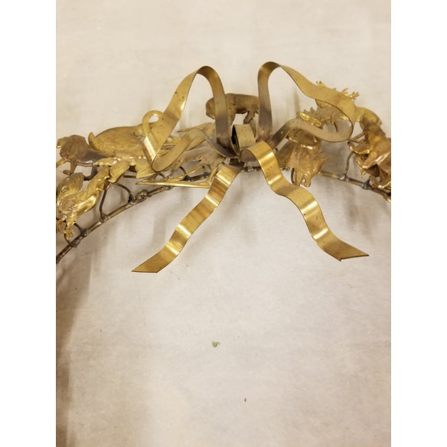 Interesting vintage Dresden All Holiday wreath...with a variety of pressed brass animals and decorative details.
