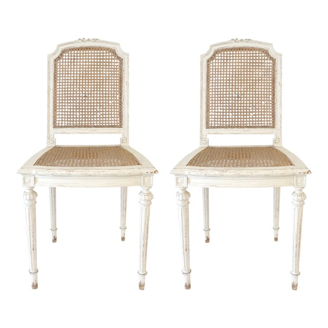 Louis XVI Style Cane Chairs With Carved Garland Detail - a Pair For Sale