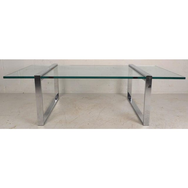 "This stunning vintage modern coffee table features 1"" thick glass with a green tint and a heavy chrome base. Elegant Mid-..."