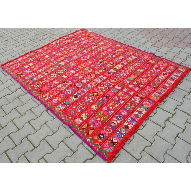 Material: Wool on wool and some syntethic Condition: Used. Newly washed. Ready to use. Rug is not perfectly rectangular....