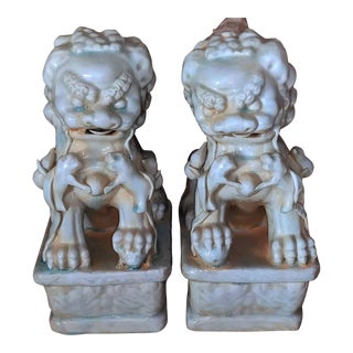 Early 20th Century Chinese Celadon Gloss Glazed Clay Guardian Foo Dog Lions - a Pair For Sale