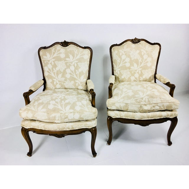 This is a pair of Meijer Gunther martini French style chairs. The pieces are finished in a dark walnut, and the upholstery...