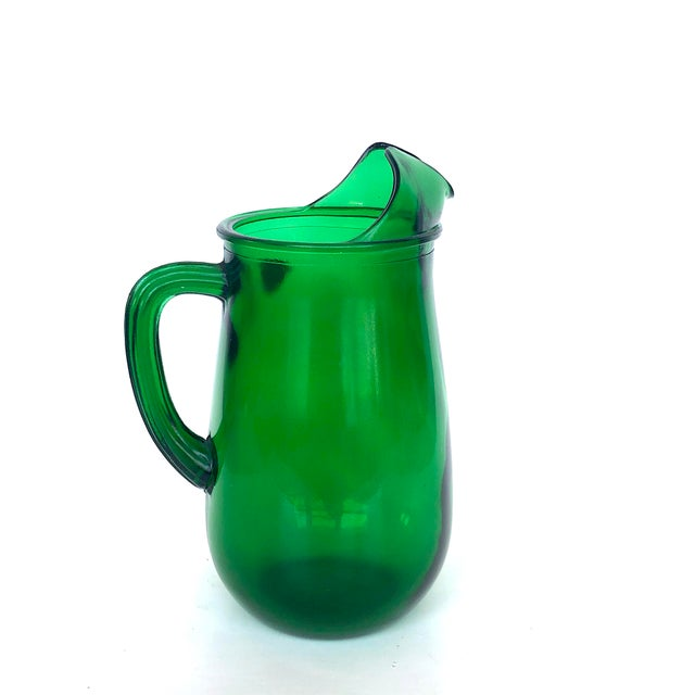 This classic vintage mid-century Forest green glass pitcher made by Anchor Hocking is the perfect vessel to serve summer...