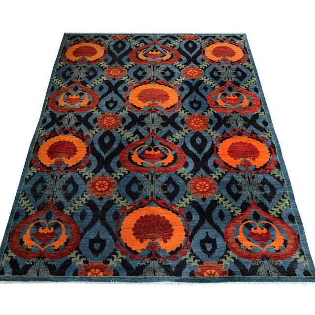 Regal and stately, this exquisite rug, hand Knotted by skilled artisans and weavers with highest quality wool, designed...