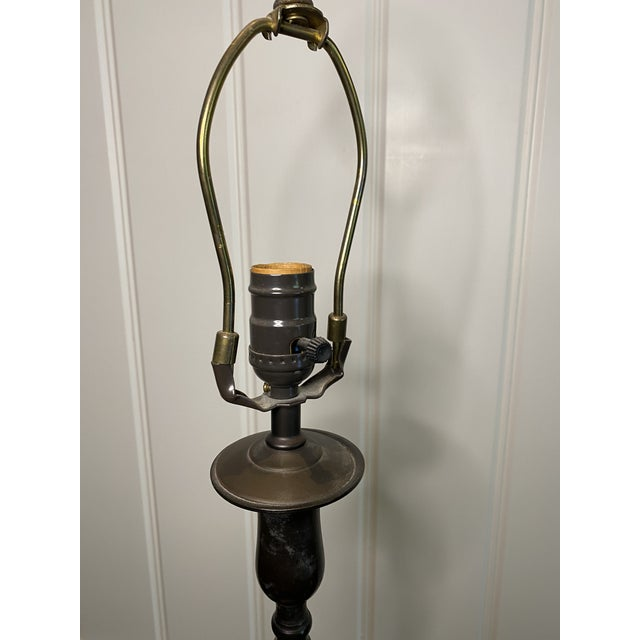 Pair of tall bronze table lamps with turned detail and acorn finial, shades not included. Purchased from Carlyle Design in...