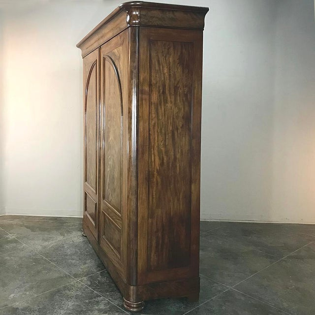 19th Century French Louis Philippe Period Burl Mahogany Armoire with commode inside is a marvel of hand-craftsmanship,...