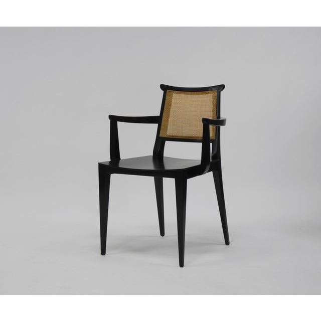 Twelve dining chairs by Edward Wormley for Dunbar. Two arm chairs, ten side chairs. Having slightly curved mahogany seats,...