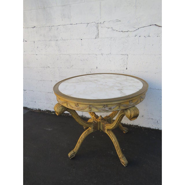 This charming Center Table is made out of wood, solid wood and marble. This classic Center Table is in good original...