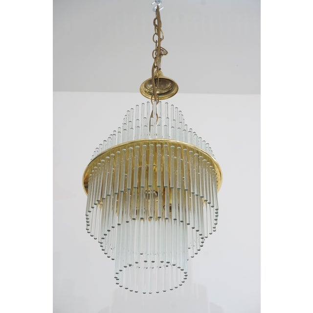 This stylish and chic mid century modern chandelier dates to the late 1960s to early 1970s and was created by V. Nason &...