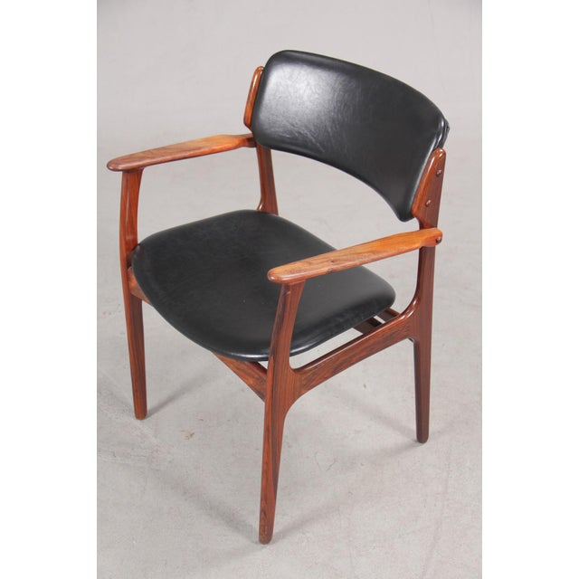 Erik Buch armchair in rosewood with excellent woodwork that are evidence of Good Design and craftsmanship. The chair...