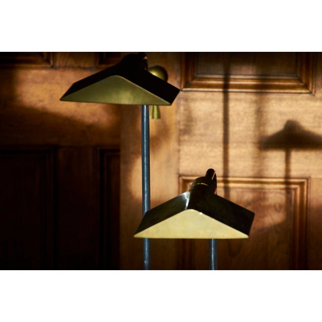 Pair of Cedric Hartman Floor Lamps, early examples Design allows adjustable positions with rotating, swivel arm Brass...