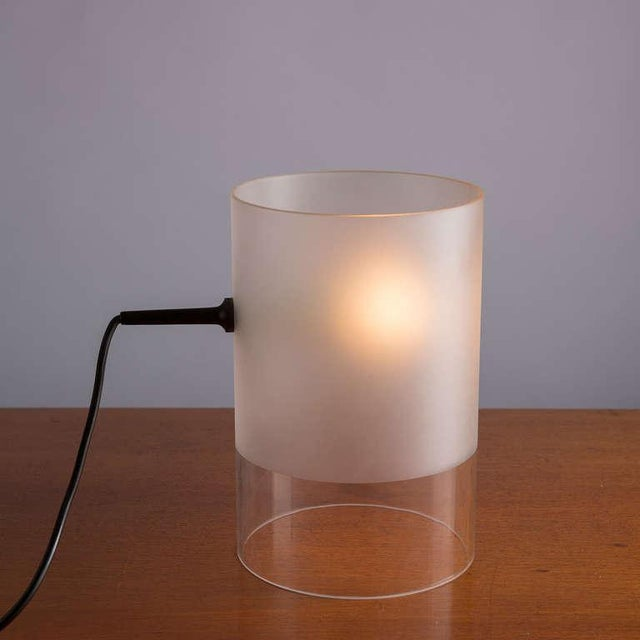 """Rare """"Fatua"""" table lamp by Guido Rosati for Fontana Arte. Totally composed by a glass cylinder with sandy part to better..."""