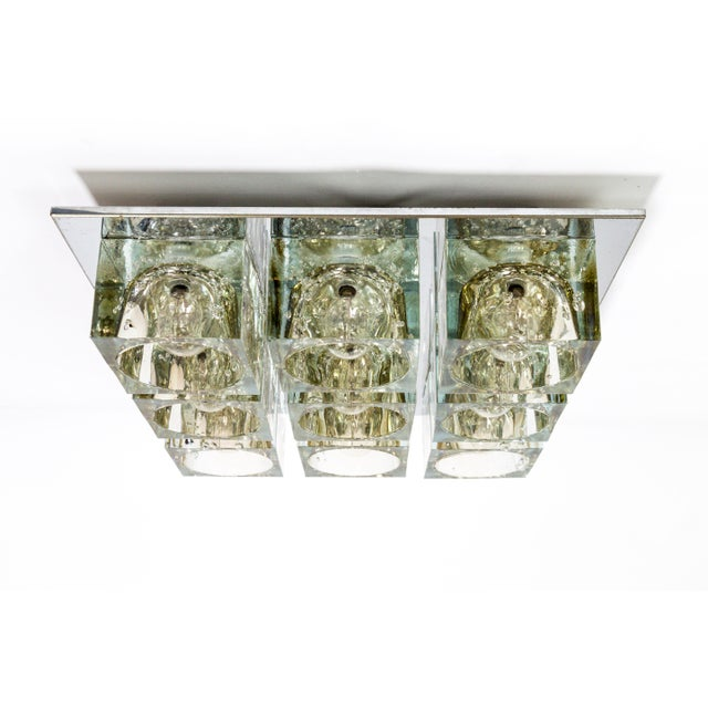 A beautiful fixture of heavy, lustrous, glass cubes mounted on chrome finished metal. By Lightolier. American, 1970's. 9...