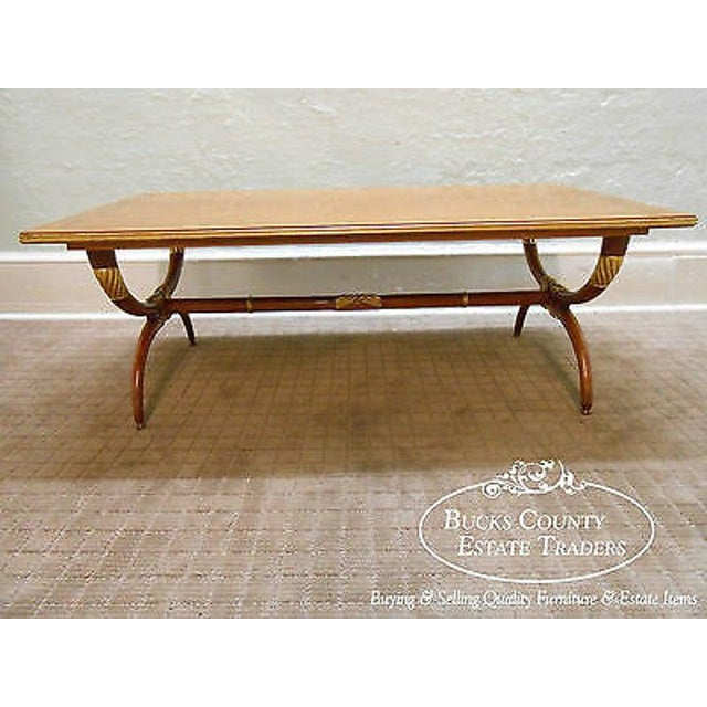 High quality, fruitwood, rectangular coffee table w/ gilt accents.