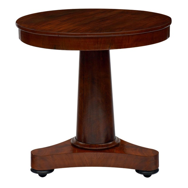 French Empire gueridon made of Cuban flamed mahogany and featuring a central tripod foot. We loved the bold lines and...