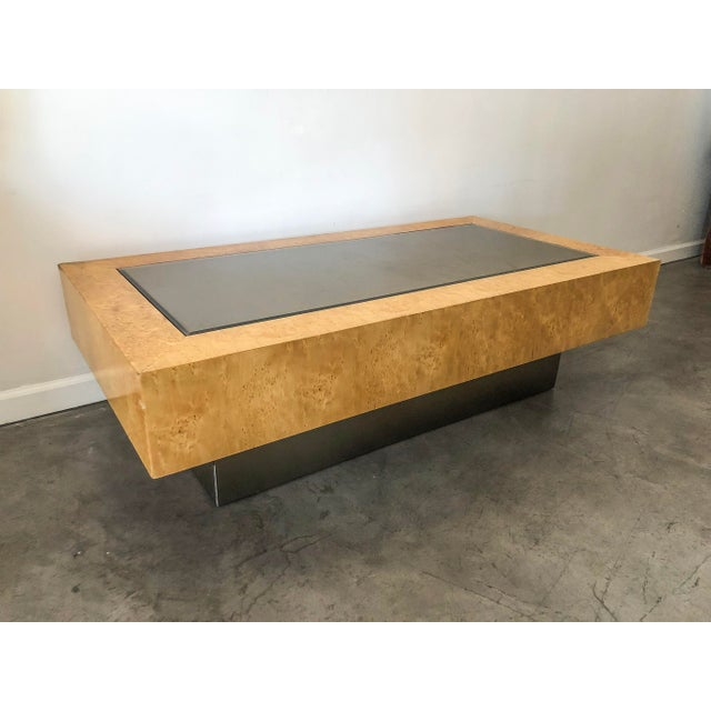 This piece is absolutely stunning-- a mid century modern burl, chrome based and smoked mirrored topped coffee table by...