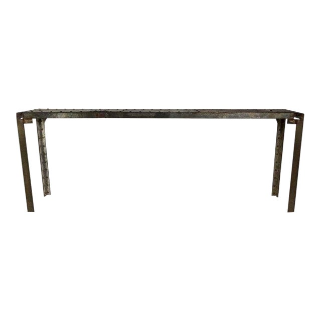 This is a fantastic industrial steel console from France, circa 1940. There are oversized steel rivets along the top,...