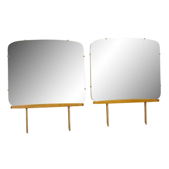 A rounded square dresser mirror with a wooden base. Priced each. Can be made into a wall mirror.