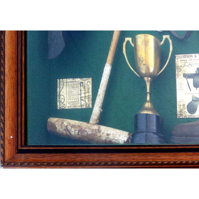 A large polo theme shadow box decorated with vintage and antique polo memorabilia. The shadow box is lined in green and...