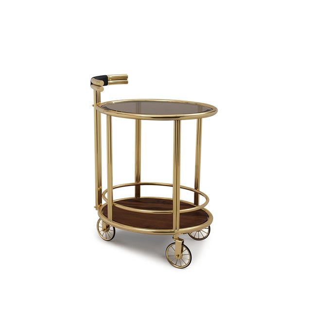 Sipping on a cocktail next to your bar cart never looked so good with Baughman, a mid-century bar cart with a stunning...