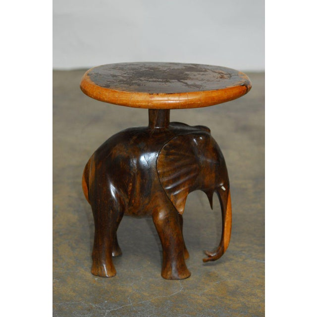 Remarkable pair of hand-carved elephant side tables or stools made from a single piece of saur wood tree trunk in Bali....