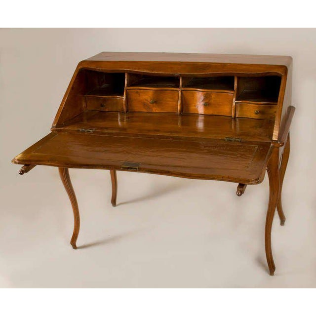 Louis XV fruitwood Bureau en Pente. Pull-out supports hold the fall front lid, opening to reveal drawers and compartments....