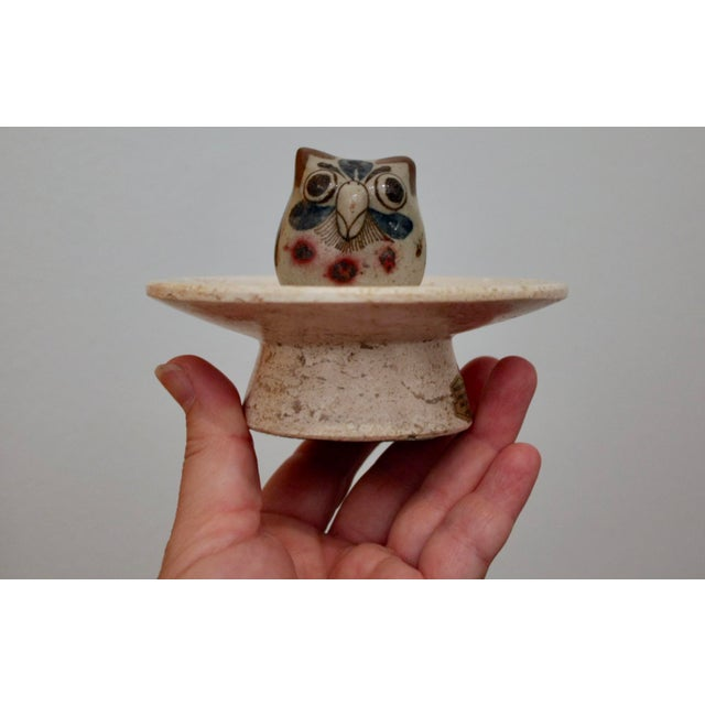 """Wonderful miniature pottery owl by Jorge Wilmot with his """"W"""" signature, displayed on a carved travertine pedestal. A..."""