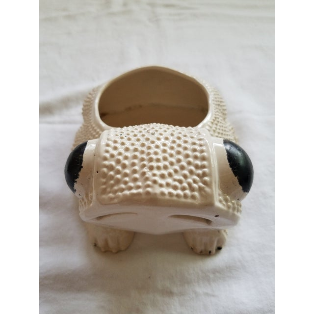 Market found, I love the texture and whimsical nature of this small white frog planter. With black painted eyes. A pottery...