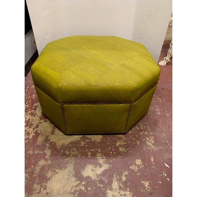 Custom designed. Ottoman with unique imported cork upholstery in green and gold. Brass studs all around. Use as an...