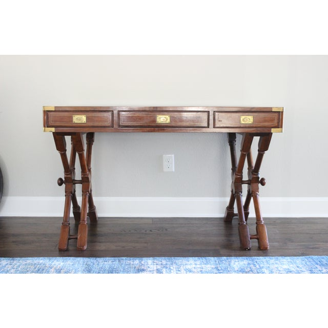 Anglo indian rosewood and brass inlay campaign desk with double x faux bamboo style legs from the 1970s with real brass...