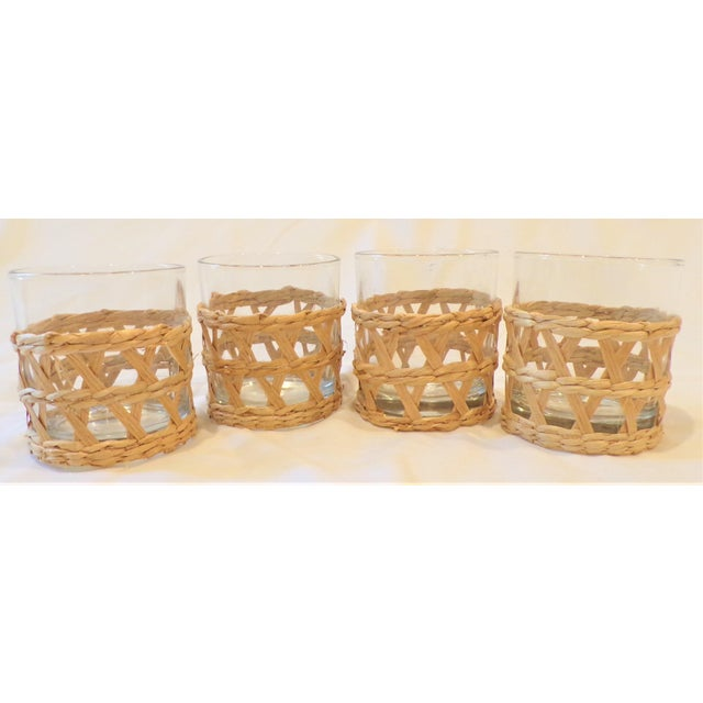 This is a fun set of double old fashion simple glasses wrapped in a natural raffia seagrass. The glasses are an inspired...