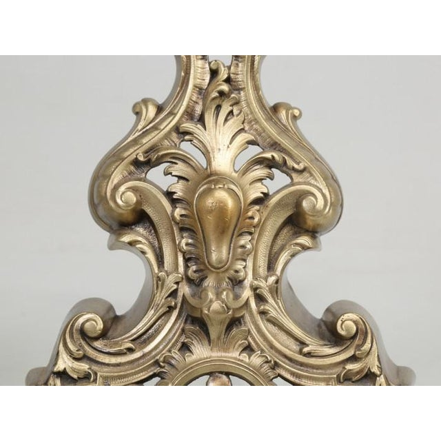 Pair of antique French bronze, Rococo style andirons that came from Toulouse. During the 19th century, the word; Rococo,...