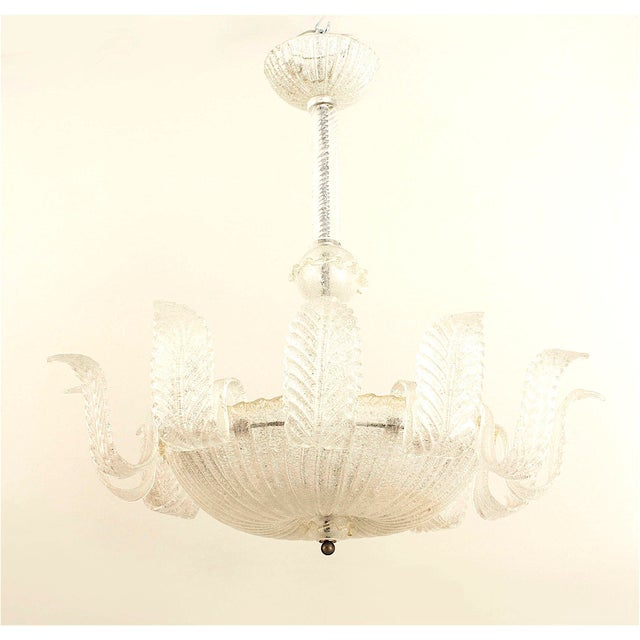 Italian Murano 1940s gold dusted and textured glass chandelier with 12 large feather form arm emanating from a large...