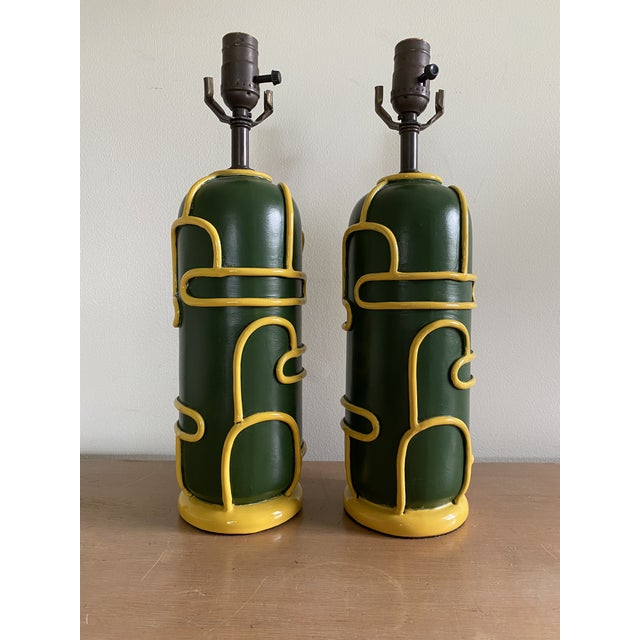 An incredibly rare pair of late 1940s modernist pottery lamps by Ugo Zaccagnini. These lamps feature a dynamic, tubular...