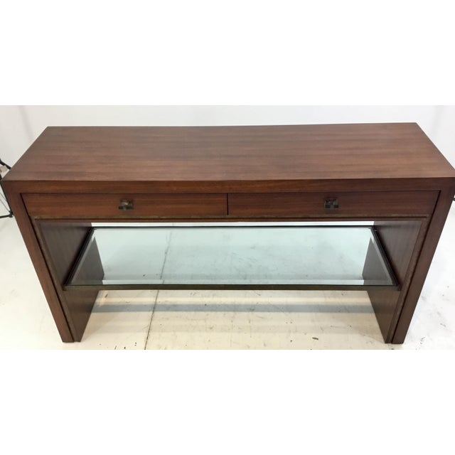 Stylish Henredon modern mahogany finished wood venue console table, two drawers with antique brass and black hardware,...