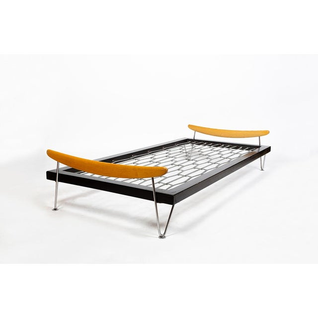 Nice beds designed by Fred Ruf in the fifties. Frame in black stained beech, chromed metal legs and wood (ash). Good...
