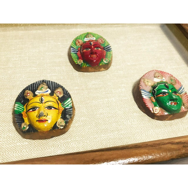 Vintage mid century hand made and hand painted shiva third eye sculptures framed in a beautiful shadow box. This piece...