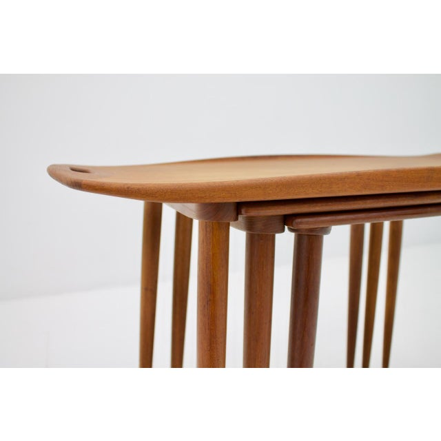 Set of three nesting tables in teak wood by Jens Quistgaard. Beautiful details, very good condition.