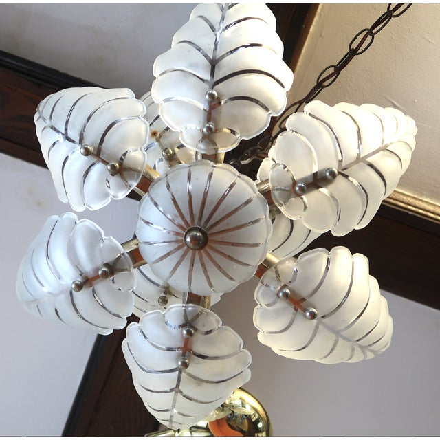 Beautiful Hollywood Regency Palm Chandelier. Aged brass and glass with the original ceiling chain. No breaks, cracks or...