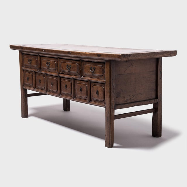 Since it was made in Shanxi province 150 years ago, this elmwood altar coffer went from having the six drawers on the...