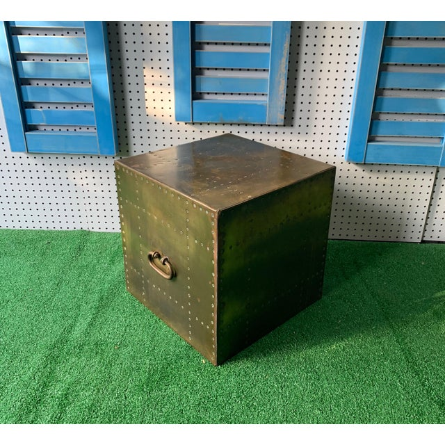 A Brass studded Cube box Table with a oval handle front on two sides. Made by Sarreid ,LTD.
