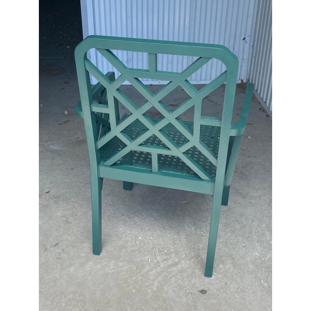 Beautiful vintage green fretwork chair. There is a beautiful cane seat. Acquired from a Palm Beach estate.