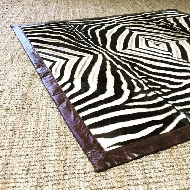 Square Patchwork Leather Trimmed Zebra Hide Area Rug- 7' X