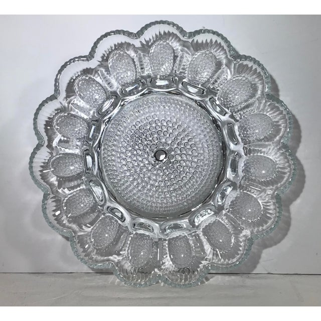 Bubble design clear patterned glass egg plate. Nice display!