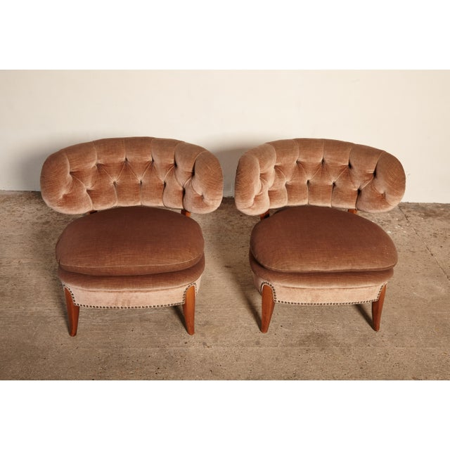 An original pair of Otto Schulz easy chairs, designed in the mid-1930s, and this pair produced in Sweden in the 1940s or...