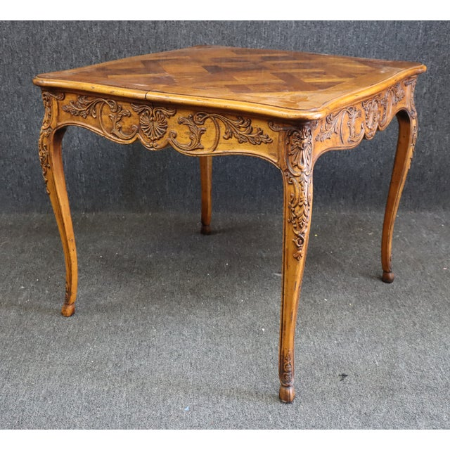 Louis XV style Dining or Game Table . Made of Fruitwood, Burlwood Parquetry top , detailed carved base . Shelf storing leaf